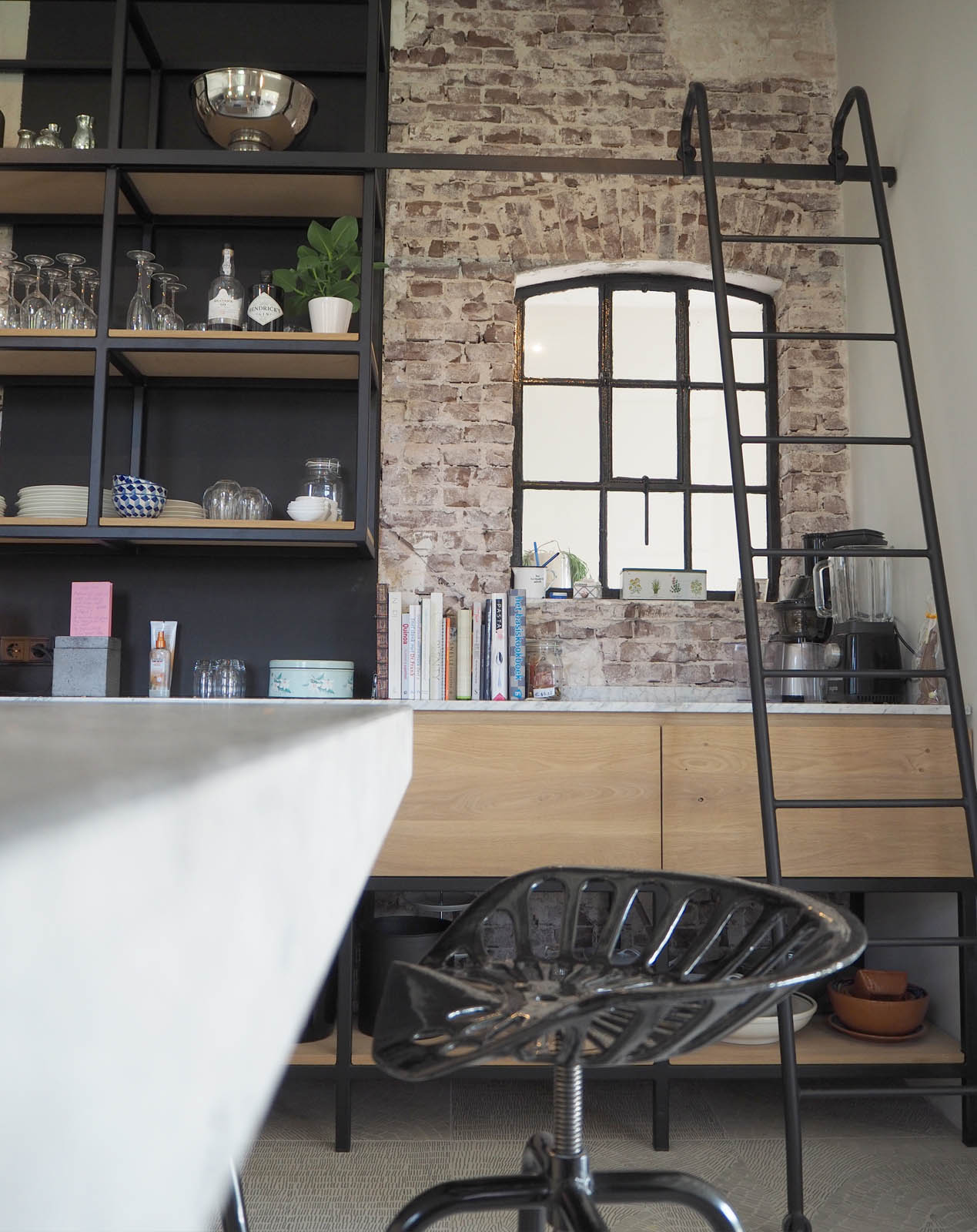 kitchen_view_marble_concrete_stairs_farm_design_jeroendenijs